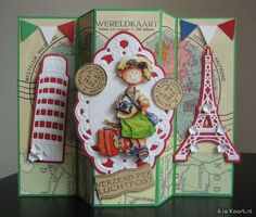 A holiday card with paper Pretty Paper bloc Journey, the oval Creatables LR0235, the Tower of Pisa is Craftables CR1222, the Eiffel Tower is Craftables CR1220, 3D is Snoesje 3DHM0039, the flags are a Joy die and the stamps are Eline's House EC0120 , finished with small flowers of a punch. 1031 cards