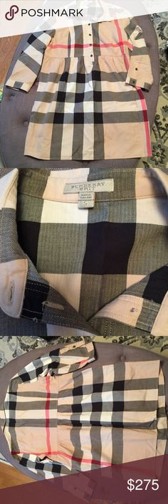 """BURBERRY BRIT CHECK TUNIC MINI DRESS Authentic Burberry Brit check babydoll/empire waist tunic. Can also be worn as dress depending on your height. Approximate measurements lying flat: shoulder 15"""", bust 18"""", length 29"""", sleeve length 18.5"""". Never worn and in mint condition, no imperfections.  💋 Reasonable offers welcome 〰 ALL measurements are approximate  🚫 Sorry, NO trades ❗️NO MODELING pics 📦 Ships w/in 24 hrs 👌🏼 Burberry Tops"""