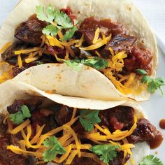 Beef simmered with garlic and peppers in a thick tomato sauce makes for a warm and satisfying dinner. A slow cooker turns a less expensive cut of meat into a flavorful stew. Serve it in flour tortillas or spoon over rice.