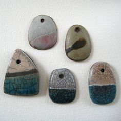 Ceramic pendants in stoneware and Raku by Jude Allman, via Flickr