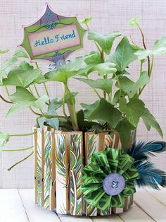 Simple DIY Clothespin Plant Holder made with decoupaged clothespins and a tuna can.  Perfect gift for Mother's Day!