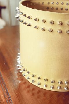 Mustard silver studded lampshade  www.bexandwhistles.com  http://www.facebook.com/BexandWhistles    Mustard cotton with silver frame and studding  size 1 - 20cm diameter x 18cm high  £55 / €64  SAMPLE PRODUCT CURRENTLY AVAILABLE AT A REDUCED COST PLEASE ENQUIRE