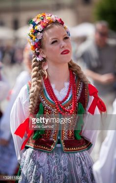 Stock Photo : 'Poland, Cracow. Polish girl in traditional dress preparing to dance in Market Square.'