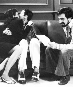 "Liza Minnelli & Robert De Niro rehearsing a kissing scene with director Martin Scorsese on the set of ""New York, New York"" (1977). COUNTRY: United States. DIRECTOR: Martin Scorsese."