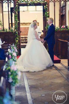 Bride and groom in church, Devon Farm wedding