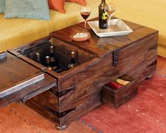 OMG the wine is just under your toes. Yes!!!  Store Wine in the Living Room: Wine Bar Treasure Trunk