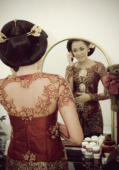 Indonesian Kebaya and traditional sanggul sunggar for the hair.