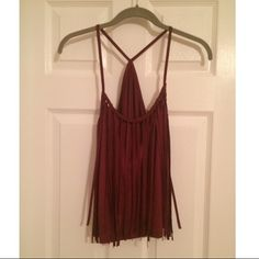 Burgundy Suede Fringe Tank Top Dark red Burgundy color, Suede Fringe Tassels Top. Faux suede material. Only worn once Tops Tank Tops
