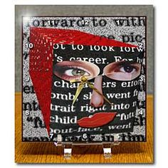 A 3D Repousse with a Face on it made from many with words and red Desk Clock