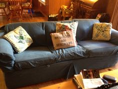 The sleeper sofa was left behind by the homes prior owners. The denim Pottery Barn-style slipcover is two piece, machine washable. $119, Amazon.