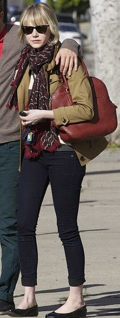 Who made  Emma Stone's black sunglasses, skinny blue jeans, and handbag?