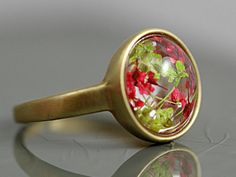 Ring with tiny dried flowers. Transparent. Brass.