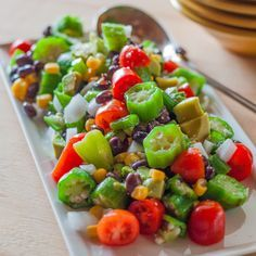 Fresh-cut okra is the star of this quick-fix summer salad with tomatoes, sweet corn, black beans, avocado, tossed in olive oil.