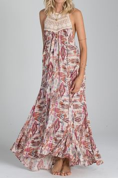 """She was a gypsy woman. Born to roam, this crochet-trimmed maxi dress spreads romantic, carefree vibes wherever it goes. •Crochet neck maxi dress. •Low cut back. •Halter tie at neck. Ruffled bottom panel, sleeveless. Features all-over print. Shoulder to hem (HPS)    Measurements:length: 52.25""""for size medium   Shine On Maxi Dress by Billabong. Clothing - Dresses - Maxi North Dakota"""