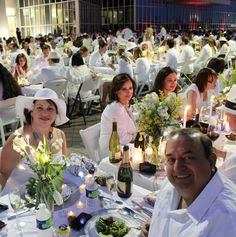 Diner en Blanc is an international pop-up picnic held at the Port of New Orleans. Image from NewOrleansUnplugged.com