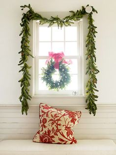 Dress a window with a basic pine garland for instant holiday cheer -- simple yet stunning. If you want a little extra decoration, hang a small wreath topped with a bright red bow inside the window.