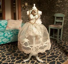 Amazing dollhouse miniature 1:12 scale hand embellished vintage dress form in vintage script, ephemera, jewelry and vintage lace skits.