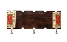 This name plate in mango wood is handcrafted with dhokra figurine & miniature warli hand painting at the border. Bells at the bottom accord an ethnic feel. When put on entrance, it adds a WOW factor to the entry into your residence. Text is handwritten. On receiving your order, we will contact you to take down the name which you desire to get painted. Visit www.indikala.com   #nameplates  #homedecor  #fancynameplates