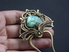 Hairpin with labradorite by on DeviantArt Wire Wrapped Jewelry, Wire Jewelry, Jewelery, Hair Cuffs, Macrame Bracelets, Metal Clay, Wire Wrapping, Hair Pins, Labradorite