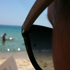 Sunglass on beautiful sardinia's beach. ;)