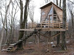 A 100 square feet treehouse near Woodstock, New York with solar and rainwater collection systems. Built by Linda Aldredge.