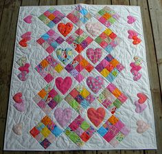 I heart baby quilts! I still have the quilt from my grandma when I was a baby.
