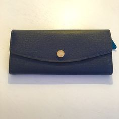 Michael Kors Navy Wallet Multi Color ✨Michael Kors Navy Wallet with Multi Color inside✨ NWT✨ Amazing compartments inside. Enough room for credit cards, money, change spot, cash slot and much more!✨ Michael Kors Bags Wallets
