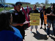 Several people gathered in front of the Rosebud Police Department to protest the ongoing treatment of domestic violence and rape victims by police officers.