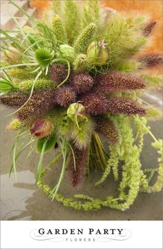 Bridal bouquet of grasses and pods by Garden Party Flowers | junebugweddings.com