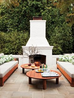 Always wanted a proper outdoor fireplace.  This is a simple, elegant design although I think I would opt to lift the firebox so that you could have a hearth to sit on!
