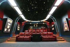 A STELLAR home theatre with led lighting on the ceiling and curved walls for maximum sound quality! This home theatre is to die for!