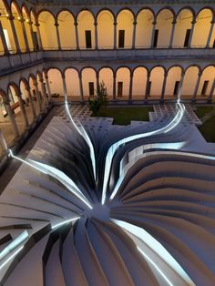 "Zaha Hadid Architects teamed with LEA Ceramiche to create ""Twirl,"" a mesmerizing installation in the 18th-century courtyard of the State University in Milan (Milan Design Week 2011)."