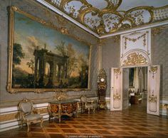 Green damask room, Neues Palais (New Palace), Sanssouci Gardens. Imaginary Italian landscape by I.Moucheron, second half 18th; chest of drawers by H.W. Spindler, 1765; upright clock, palisander wood and intarsia by J.F. Spindler.  Palace Neues Palais, Potsdam, Germany