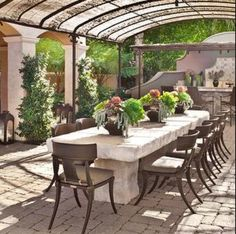 Beautiful outdoor space- love the rustic table and floor pattern