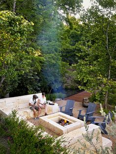 The stone fire pit is nestled at the end of the peninsula where the two creeks meet