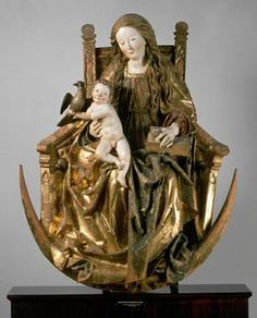 A wooden figure of the Virgin Mary and Child seated above a symbolic crescent moon, c.1510, attributed to Niklaus Weckmann the Elder; the Christ Child embraces the Holy Spirit in the form of a dove. (Kunsthistorisches Museum Vienna)