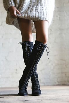 Lace up boots and oversize sweater dress.