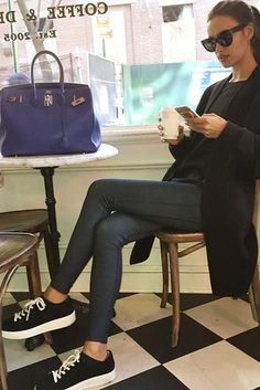 Irina Shayk wearing Celine Large Audrey Sc 1755 Black Sunglasses, Scoop Suede Low Top Laceup Sneaker, Hermes 35cm Electric Blue Togo Leather Birkin Bag with Palladium Hardw and Replay Jeans Hyperskin Jeggings