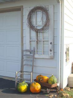 outdoor autumn decor, seasonal holiday decor, window chair pumpkins and rusty wagon make a beautiful outdoor autumn display