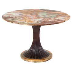 Early Osvaldo Borsani Table with Onyx Marble Top | From a unique collection of antique and modern tables at http://www.1stdibs.com/furniture/tables/tables/