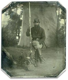 A beautiful tintype of an unidentified Federal soldier. His branch of service is artillery and the presence of infantry accouterments and a musket would probably indicate Heavy Artillery.