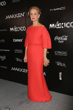 Lady of the hour: Carolina Herrera, 75, wore a striking red gown to the event, which Olivi...