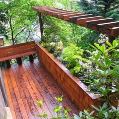 Second story deck with small pergola and flower box: