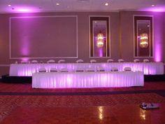 Pink Uplighting head table from www.erieuplighting.com  814-873-5100