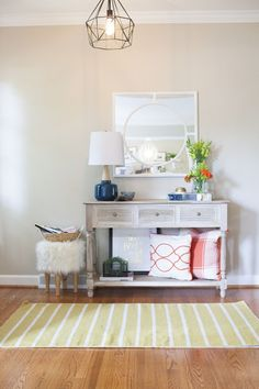 bright and airy entryway  ||  neutral entry with pops of color  ||  modern entryway  ||  designPOST interiors
