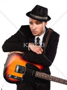thoughtful businessman with guitar. - Thoughtful businessman with guitar against white background, Model: Kareem Duhaney