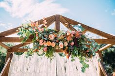 Wedding ceremony, macrame backdrop, floral altar, wood altar, wedding ceremony boho outdoor Ruffled - photo by Cara Robbins Photography http://ruffledblog.com/floral-inspired-treehouse-wedding | Ruffled