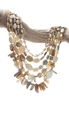 The Shelle Necklace. Shell, mother-of-pearl, and agate beads are hand selected, then knotted and looped onto silk thread to create this one-of-a-kind necklace.