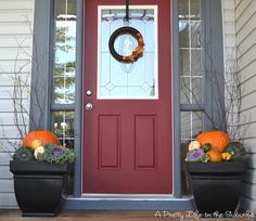 Love these fall planters. I'd like matching planters like these eventually. A Pretty Life in the Suburbs.