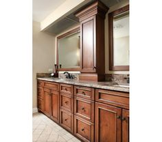 Master bathroom vanity with his and hers sinks and shallow medicine cabinet.